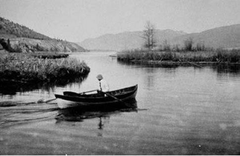 Photo of the Okanagan River flowing through a large marsh, now destroyed, at the outlet of Okanagan Lake, Penticton. Photo taken in 1912.